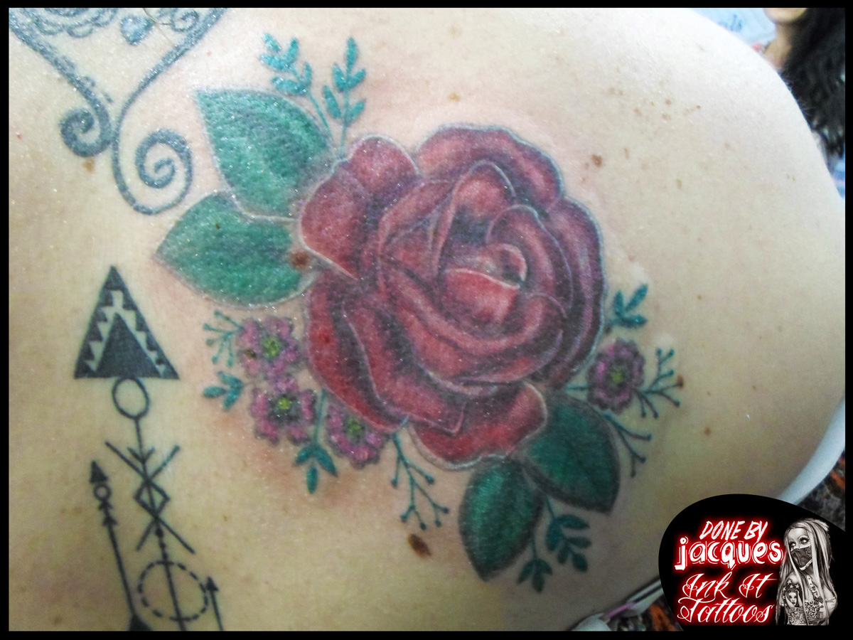 Rose colour tattoo done by Jacques Jooste of Ink It Tattoos