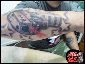 Trash Polka Gun Tattoo